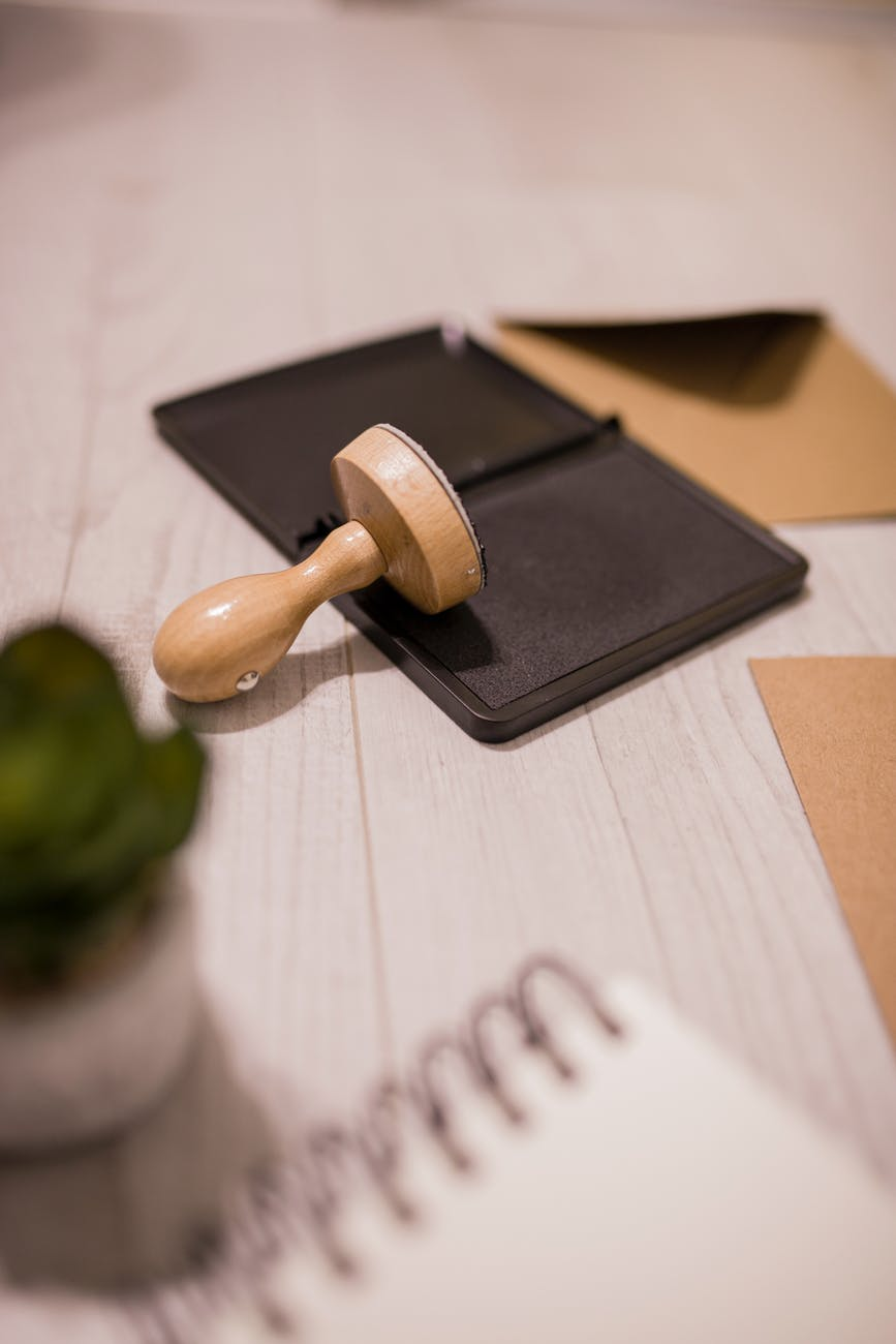 wooden stamp on ink pad placed on desk